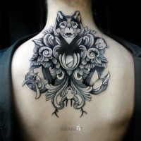 Illustrative style upper back tattoo of wolf with flowers