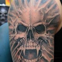 Impressive black and white mystical shoulder tattoo of demonic vampire skull
