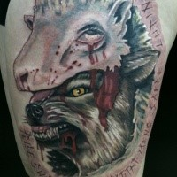 Impressive creepy looking colored thigh tattoo of bloody wolf in sheep skin