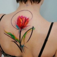 Impressive design red tulip flower colored tattoo on central back in watercolor style