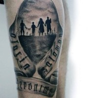 Impressive painted black and white family with lettering and ribbon tattoo on leg