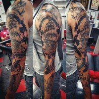 Impressive painted black and white nautical themed tattoo on sleeve