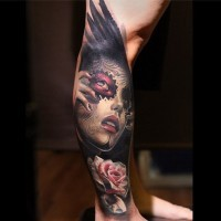 Incredible big black ink crow wing tattoo on leg stylized with Mexican traditional woman portrait and flowers