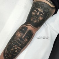 Incredible looking colored arm tattoo of demonic Jesus face with crying woman with cross