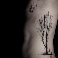 Incredible style painted black ink lonely big tree tattoo on side with moon