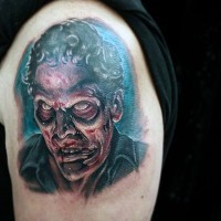 Incredible very detailed colorful shoulder tattoo of zombie man portrait