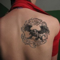 Ink griffin tattoo with lettering for boys