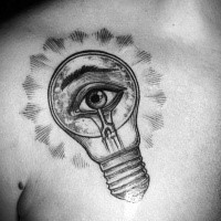 Interesting engraving style chest tattoo of bulb with human eye