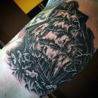 Interesting pained black ink old pirate ship tattoo on arm