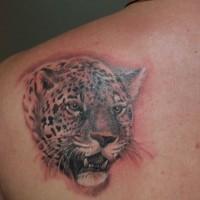 Jaguar tattoo on shoulder blade