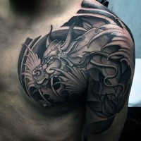 Japanese traditional black ink shoulder and chest tattoo of big fantasy dragon