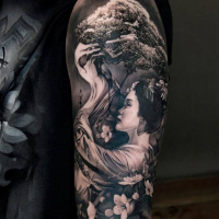 Japanese woman and tree tattoo on shoulder
