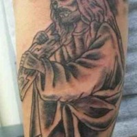 Jesus carries his cross forearm tattoo