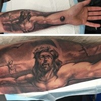 Jesus Christ suffering on crucifix forearm length religious tattoo
