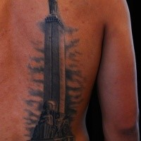 Large amazing looking back tattoo of enormous stone statue