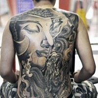 Large black ink whole back tattoo of Buddha statue with dragon