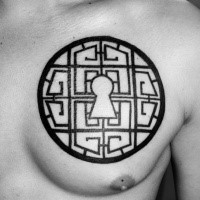 Large blackwork style chest tattoo of circle shaped lock