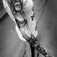 Large blackwork style painted by Inez Janiak sleeve tattoo of demonic woman with wolf