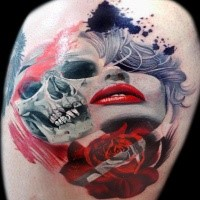 Large colorful thigh tattoo of woman with skull and rose