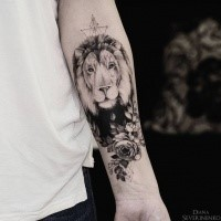 Large dot style forearm tattoo of big lion head with flowers