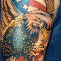 Large eagle on usa flag colored tattoo
