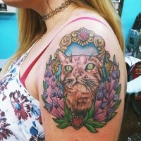 Large for girls style colored shoulder tattoo of cat portrait with flowers