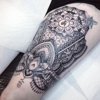 Large Hinduism themed thigh tattoo of big ornament with symbol