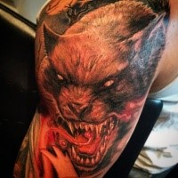 Large illustrative style colored shoulder tattoo of demon werewolf