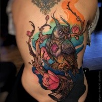 Large new school style colored whole back tattoo of fantasy owl with tree and flowers