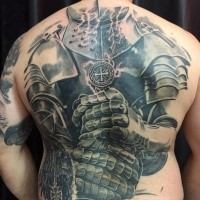 Large very detailed whole back tattoo of big medieval knight armor