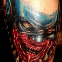 Large video games style colored bloody monster face tattoo