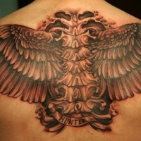 Large wings tattoo on back