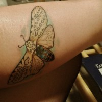Leopard moth tattoo for boys