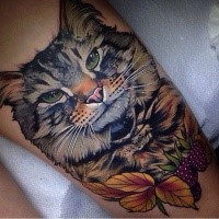 Lifelike beautiful looking colored big cat tattoo with leaves and berries
