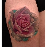 Lifelike beautiful looking thigh tattoo of rose with water bulbs