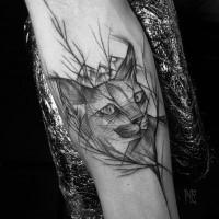 Lifelike black ink forearm tattoo by Inez Janiak of wild cat