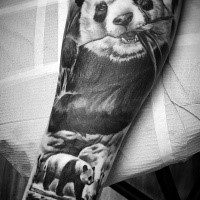 Lifelike breathtaking detailed forearm tattoo of cute panda bear eating grass