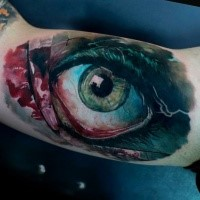 Lifelike colored biceps tattoo of bloody human eye