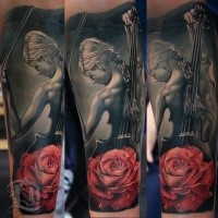 Lifelike colored forearm tattoo of woman with violin with rose