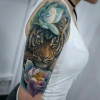 Lifelike colored shoulder tattoo of little liger with flowers