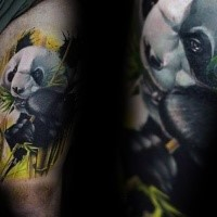 Lifelike colored thigh tattoo of panda bear with bamboo