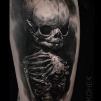Lifelike detailed tattoo of alien skeleton by Eliot Kohek