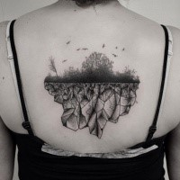 Lifelike nice looking back tattoo of forest with birds and rock