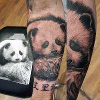 Lifelike very beautiful cute forearm tattoo of baby panda with lettering