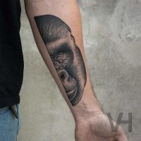 Lifelike very beautiful painted by Valentin Hirsch forearm tattoo of split gorilla head