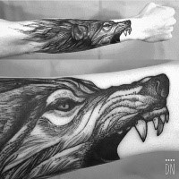 Linework style black ink arm tattoo of evil wolf head