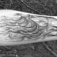Linework style black ink forearm tattoo of evil fox head with waves