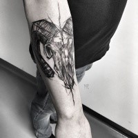 Linework style painted by Inez Janiak arm tattoo of animal skull