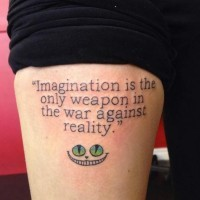 Literary style quote lettering in printed letters with Cheshire cat's smile colored tattoo on thigh