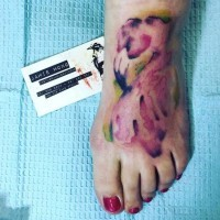 Little abstract style designed and colored flamingo tattoo on foot